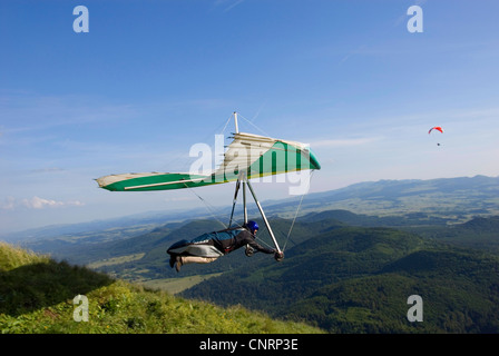 at Puy de Dome  and view onto the volcanic landscape Chaine des Puys', France, Auvergne - Stock Photo