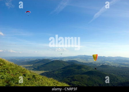 hang gliders at Puy de Dome  and view onto the volcanic landscape Chaine des Puys', France, Auvergne - Stock Photo