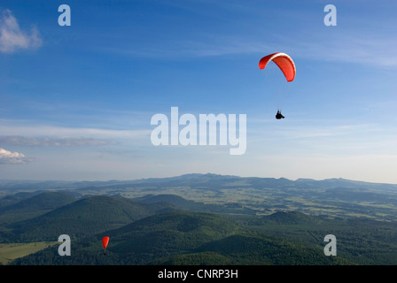 paragliders at Puy de Dome  and view onto the volcanic landscape Chaine des Puys', France, Auvergne - Stock Photo