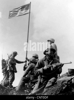 Digitally restored vector photograph of the 1st American flag raising during the Battle Of Iwo Jima on Mount Suribachi. - Stock Photo