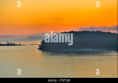 The Stockholm Archipelago along the Swedish coast seen from the Baltic Sea at sunrise.Summer holiday cottages are - Stock Photo