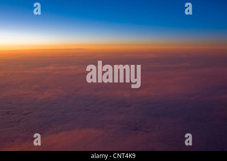 sunset over clouds - Stock Photo