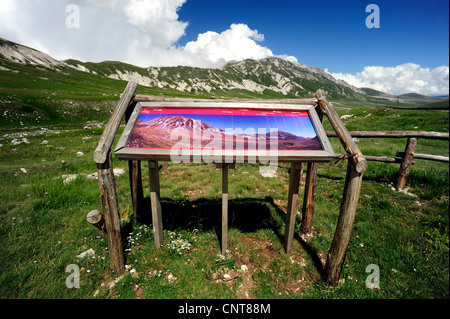 panorama sign in front of mountain range with information about the different mountain tops, Italy, Abruzzo - Stock Photo