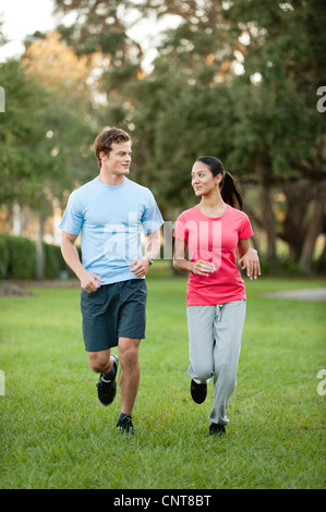 Young could jogging on grass - Stock Photo