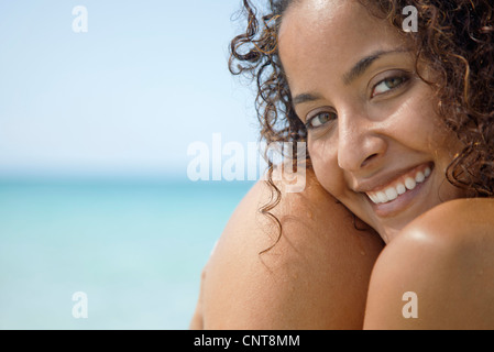 Woman at the beach, smiling, portrait - Stock Photo