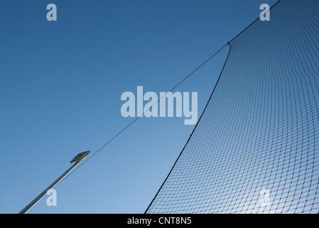 Sports net against blue sky - Stock Photo