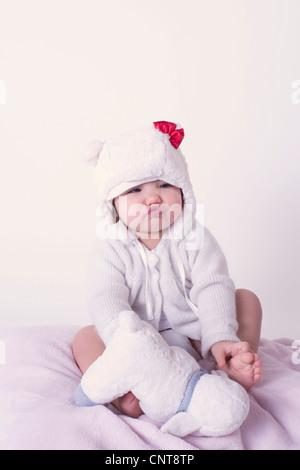 Baby girl pursing lips, portrait - Stock Photo