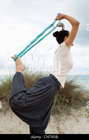 a woman dressed in exercise wear taking a rest in the