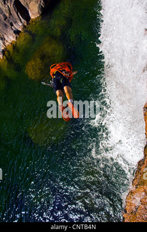 young woman canyoning in Corsica island, Bavella mountains taking a header, France, Corsica - Stock Photo