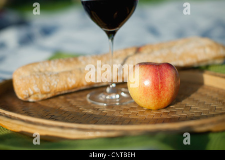 Apple, glass of wine and bread - Stock Photo