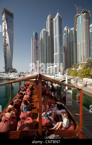 The skyscrapers of the 'Dubai Marina' area seen from a traditional dhow (Dubai - the United Arab Emirates). - Stock Photo