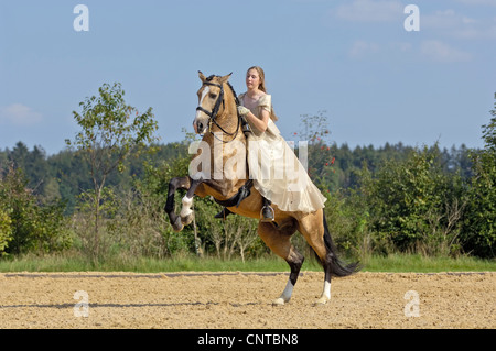 Girl Wearing A Historic Dress Riding On A Lusitano Horse