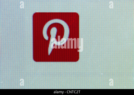 Enlarged portion of the Pinterest symbol on website showing pixel effect of computer screen. - Stock Photo