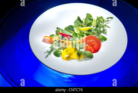 plate with portion of fresh mixed salad salat mix mixture fitness fit FOOD lamb's lettuce salad mache vegetables - Stock Photo