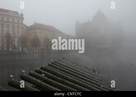 Morning fog over the Vltava River in Prague, Czech Republic. - Stock Photo
