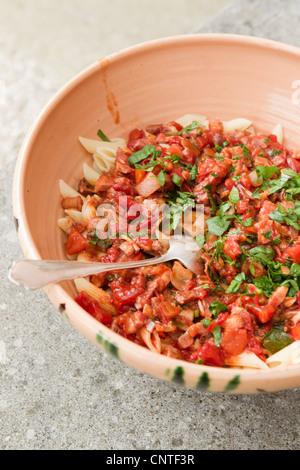 Close up of bowl of pasta with sauce - Stock Photo