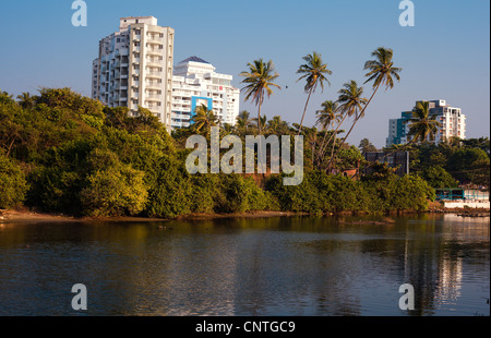 buildings, water in foreground - Stock Photo