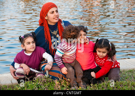 Egyptian mother and her children at Ala Azhar park Cairo Egypt - Stock Photo