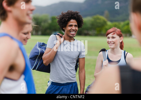Runners talking in park - Stock Photo