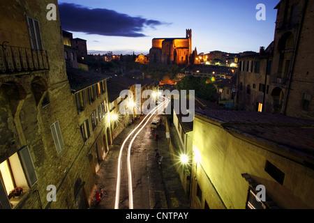Basilica of San Domenico by night, Siena, Tuscany, Italy - Stock Photo