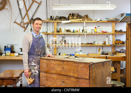 Carpenter working on wooden drawers - Stock Photo