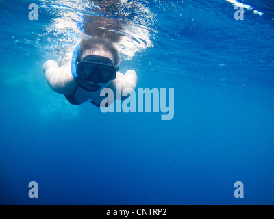 Woman swimming in snorkeling mask - Stock Photo