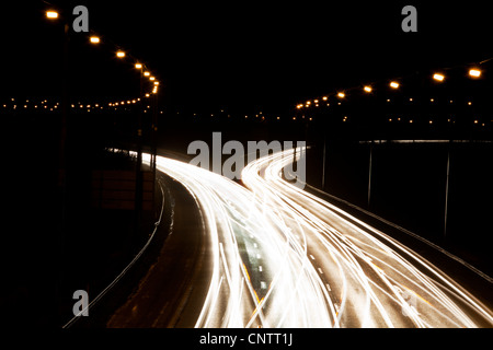Time-lapse view of traffic at night - Stock Photo