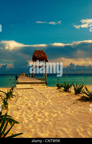 A dock on the main beach of Isla Mujeres. - Stock Photo