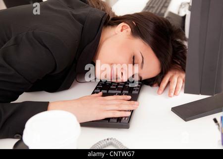 Businesswoman asleep at desk
