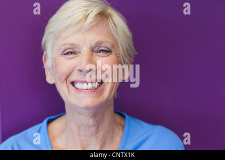 Close up of older womans smiling face - Stock Photo