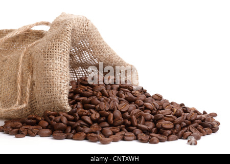 Coffee beans overflowing - Stock Photo