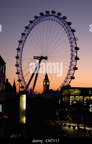 London, UK - January 21, 2011: London Eye and Westminster in the distance seen from Waterloo Bridge at dusk [Editorial - Stock Photo