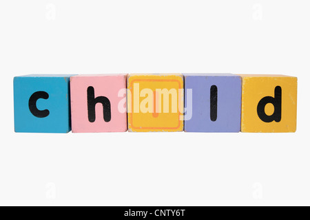 assorted childrens toy letter building blocks against a white background that spell child with clipping path - Stock Photo