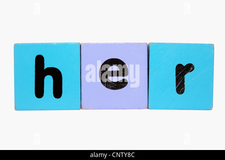 assorted childrens toy letter building blocks against a white background that spell her with clipping path - Stock Photo
