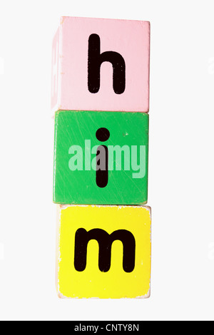 assorted childrens toy letter building blocks against a white background that spell him with clipping path - Stock Photo