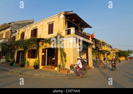 Horizontal cityscape view along Bạch Đằng street in Hoi An Old Town, Vietnam on a sunny evening. - Stock Photo