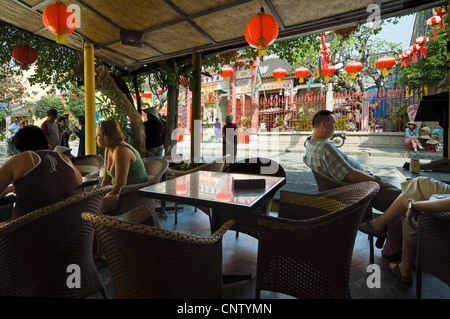 Horizontal exterior view of the Hội Quán Quảng Triệu, Quang Trieu Assembly Hall, from a cafe in the centre of Hoi - Stock Photo