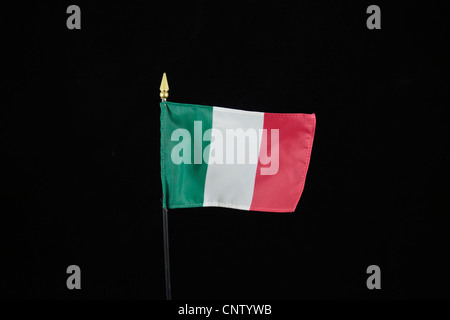 The national flag of the Italian Republic on a black background. - Stock Photo