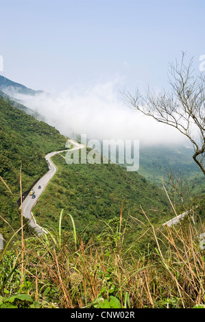 Vertical wide angle view along the Annamite mountain range and the hair-pin bends along the Hai Van Pass. - Stock Photo
