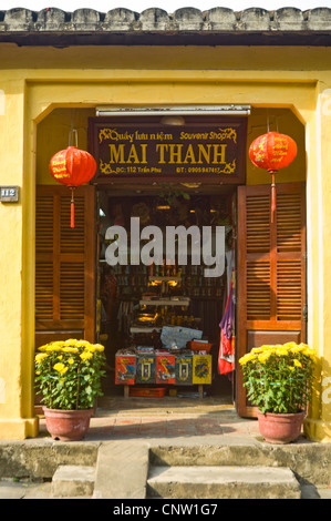 Vertical close up of a traditional souvenir shop front in Hoi An Old Town, Vietnam on a sunny day. - Stock Photo