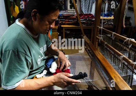 Man weaving Otavalo Ecuador - Stock Photo