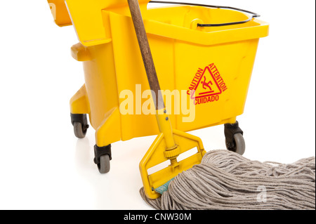 Close-up of Industrial mop and bucket isolated on white background with paths - Stock Photo