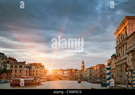 Buildings and ferryboat on urban canal - Stock Photo