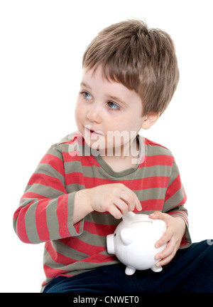 Young boy saving money in piggybank - Stock Photo