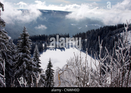 winter landscape with snow-covered Lake Mummel, Mummelsee, Germany, Baden-Wuerttemberg, Black Forest - Stock Photo