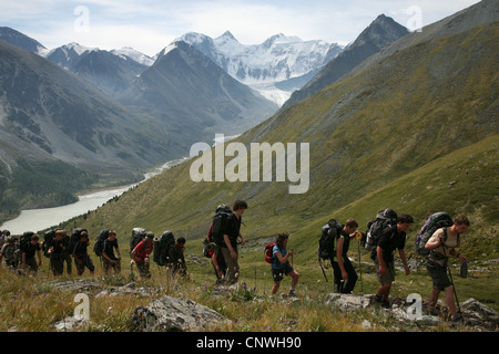Group of trekkers climbing up the mountain pass Karaturek (3,060 m) in the Altai Mountains, Russia. - Stock Photo