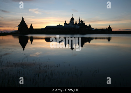 Solovetsky Monastery on the Solovetsky Islands, White Sea, Russia. View from Saint Lake at sunset. - Stock Photo