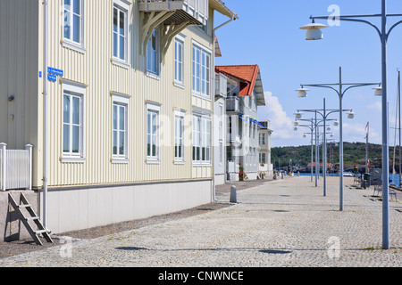 Small apartment house built on the coast with sea view, Boardwalk with street lighting - Stock Photo