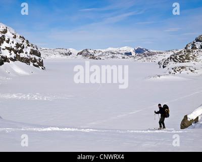 Male skier ski touring in Norway's Hardanger region - Stock Photo