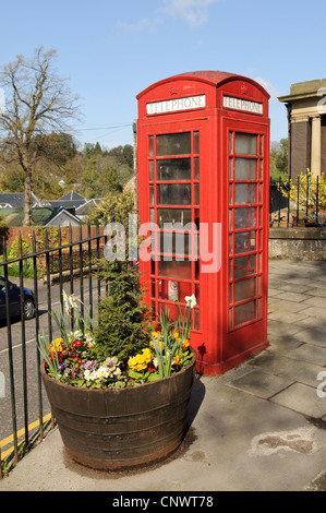 Red Phone Box and floral display in Colinton Village, Edinburgh. - Stock Photo